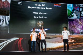 Pedrosa, Marquez and HRC Director-General Manager Race Operation Management Division Mr. Tetsuhiro Kuwata at Honda Press Event EICMA 2017